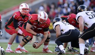 Maryland lineman Bennett Fulper, shown in 2010 hiking the ball to Danny O'Brien, during an NCAA college football game against Wake Forest. (AP Photo/Nick Wass)