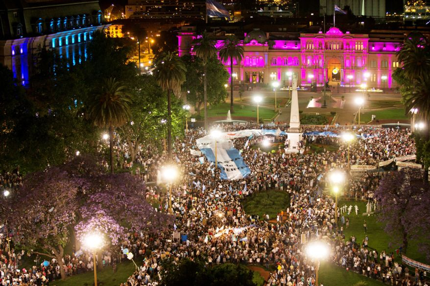 Protesters demonstrate against Argentina's President Cristina Fernandez in front of the government house in Buenos Aires, Argentina.  (AP Photo/Victor R. Caivano)