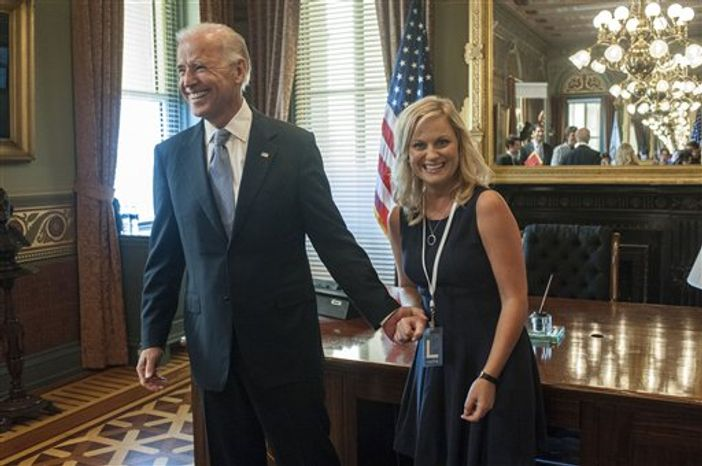 "This undated image released by NBC shows Vice President Joe Biden, left, with actress Amy Poeher, who plays Leslie Knope on the NBC comedy ""Parks and Recreation,"" in Washington. Biden will appear on the NBC sitcom ""Parks and Recreation"" on Thursday, Nov. 15. (AP Photo/NBC, David Giesbrecht)"