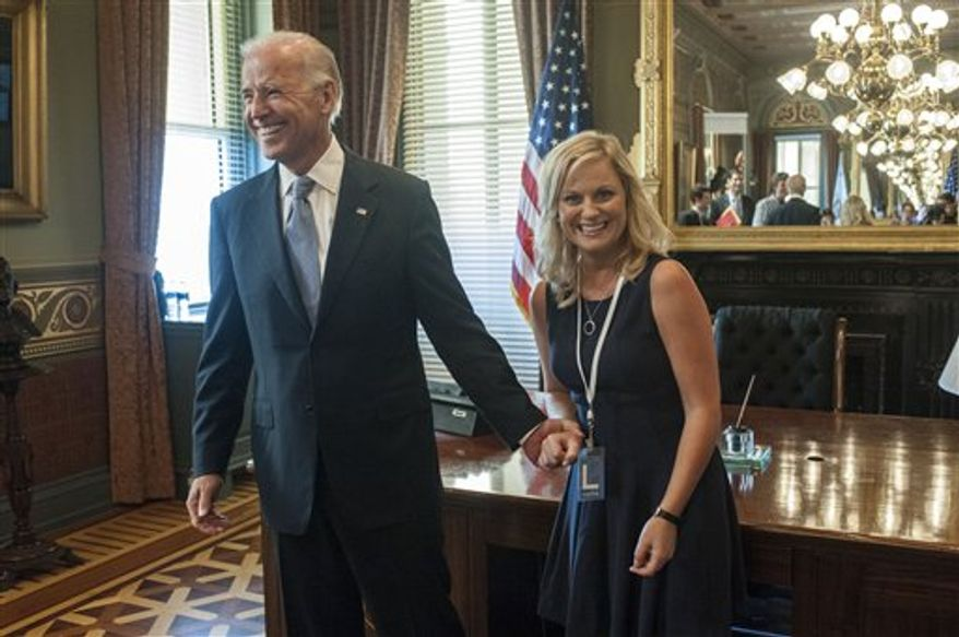"""This undated image released by NBC shows Vice President Joe Biden, left, with actress Amy Poeher, who plays Leslie Knope on the NBC comedy """"Parks and Recreation,"""" in Washington. Biden will appear on the NBC sitcom """"Parks and Recreation"""" on Thursday, Nov. 15. (AP Photo/NBC, David Giesbrecht)"""