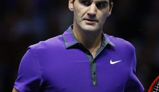 Roger Federer of Switzerland reacts to winning a point as he plays David Ferrer of Spain during their ATP World Tennis Finals singles match in London, Thursday, Nov.  8, 2012. (AP Photo/Kirsty Wigglesworth)
