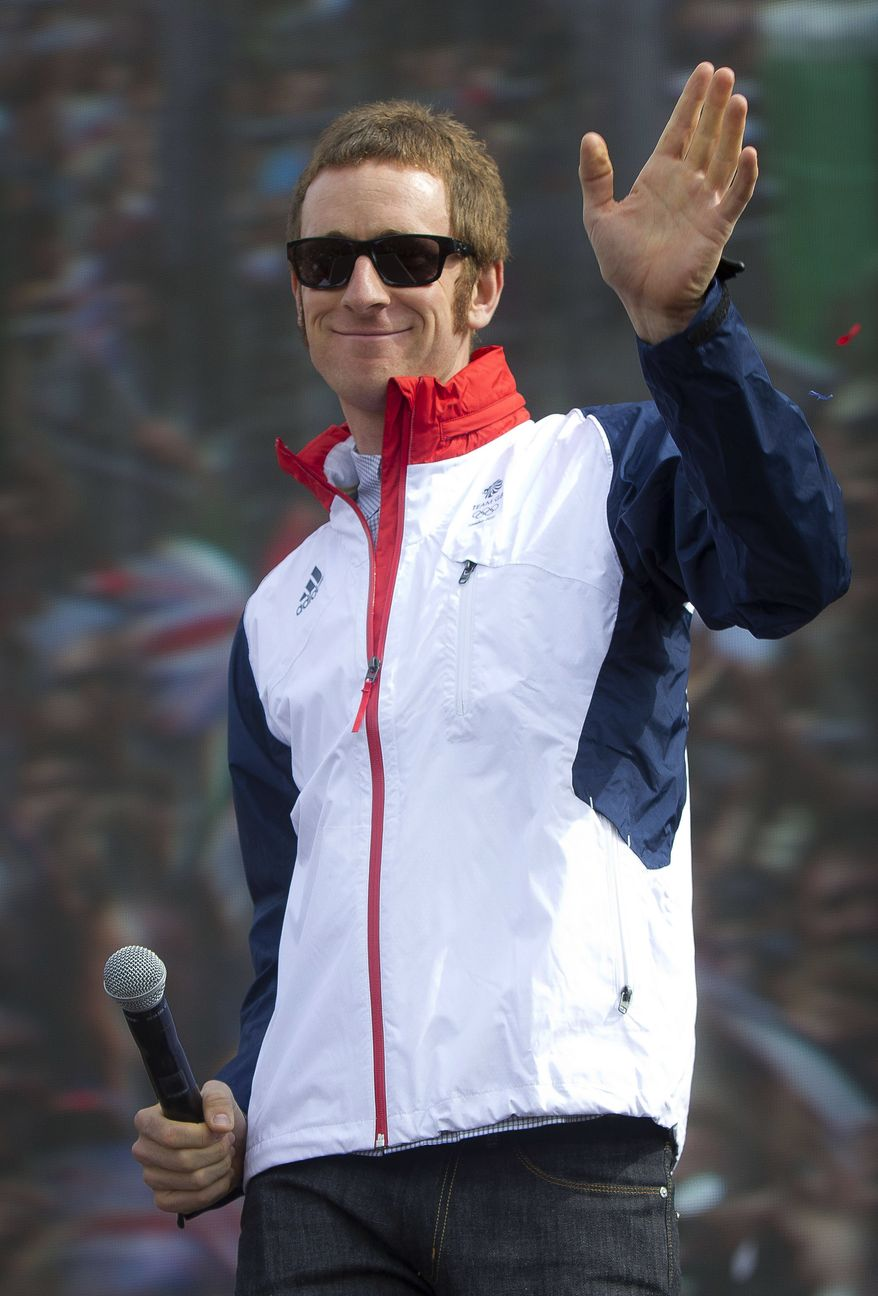 """FILE - In this Saturday, Aug. 4, 2012 file photo, British cyclist Bradley Wiggins greets fans on stage for BT London Live concert at Hyde Park in central London. Tour de France champion Bradley Wiggins was recovering in hospital Wednesday, Nov. 7, 2012, after being hit by a car while riding his bike in northern England. Team Sky said Wiggins will be kept in the hospital overnight for observation, but that """"the injuries he sustained are not thought to be serious and he is expected to make a full and speedy recovery."""" (AP Photo/Joel Ryan, File)"""
