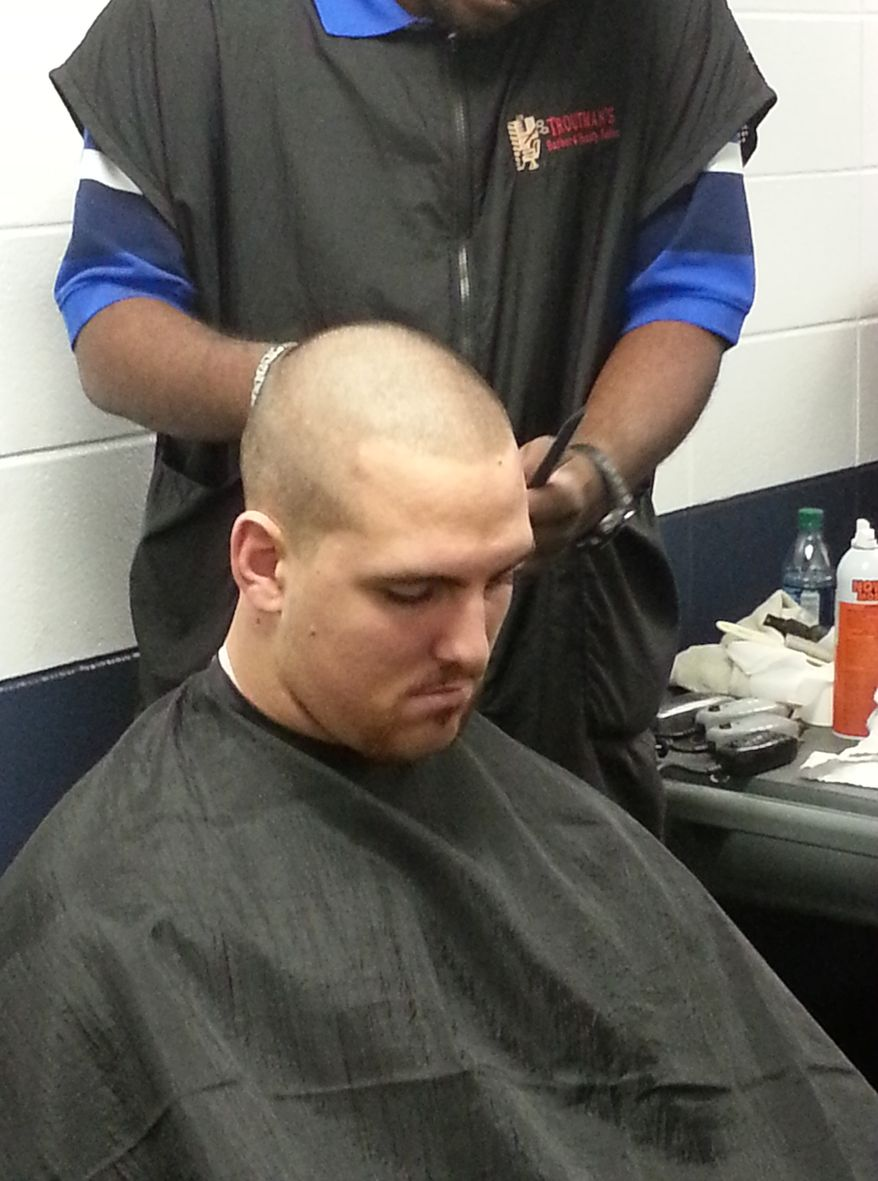 In this photo made Tuesday, Nov. 6, 2012 and provided by the Indianapolis Colts, Colts tackle Anthony Castonzo gets his head shaved following NFL football practice in Indianapolis. The Colts are going to great lengths to support their ailing coach Chuck Pagano. In a show of support, a group of about a dozen players shaved their heads after Tuesday's practice. Pagano lost his hair while undergoing treatment for leukemia. (AP Photo/Indianapolis Colts)