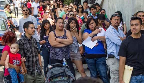 **FILE** A line of legal immigrants wait outside the Coalition for Humane Immigrant Rights in Los Angeles on Aug. 15, 2012. Hundreds of thousands of young illegal immigrants scrambled to get papers in order, as the U.S. started accepting applications to allow them to avoid deportation and get a work permit, but not a path to citizenship. President Obama announced the program in June after pressure from Hispanic voters and others who said he hasn't fulfilled a campaign promise to overhaul tangled U.S. (Associated Press)