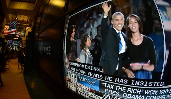 "A television feed on the floor of the New York Stock Exchange shows President Obama (left) and his daughter, Malia, on Nov. 7, 2012, the day after he was re-elected. U.S. investors dumped stocks and turned their focus to a world of problems, including a ""fiscal cliff"" of tax increases and spending cuts at home and a deepening recession in Europe. (Associated Press)"