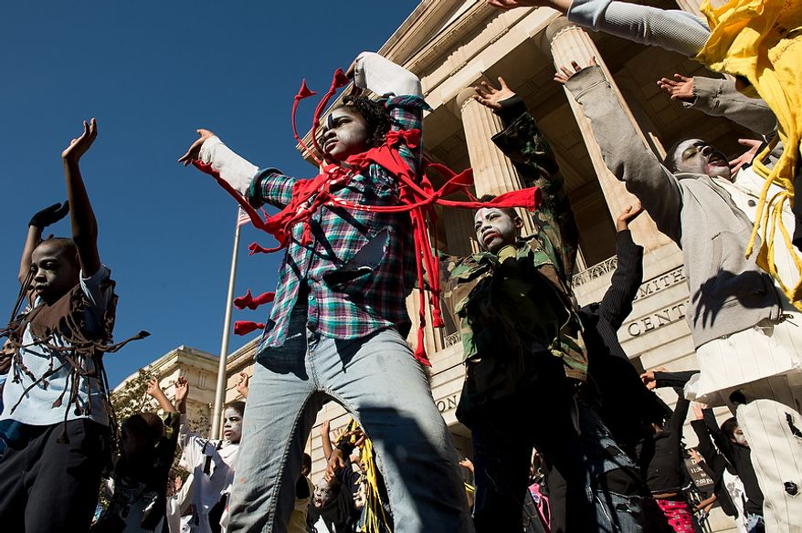 "Savoy Elementary School students perform a flash mob dance to Michael Jackson's ""Thriller"" in front of the National Portrait Gallery as a way to teach music theory, movement and the impact of the song on the music industry and the ""cultural fabric of our society,"" Washington, D.C., Thursday, November 8, 2012. (Andrew Harnik/The Washington Times)"