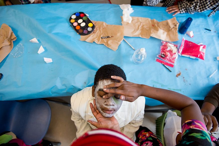 "Nakijah Pace, 9, and other Savoy Elementary School students get their makeup done before performing in a flash mob dance to Michael Jackson's ""Thriller"" in front of the National Portrait Gallery as a way to teach music theory, movement and the impact of the song on the music industry and the ""cultural fabric of our society,"" Washington, D.C., Thursday, November 8, 2012. (Andrew Harnik/The Washington Times)"