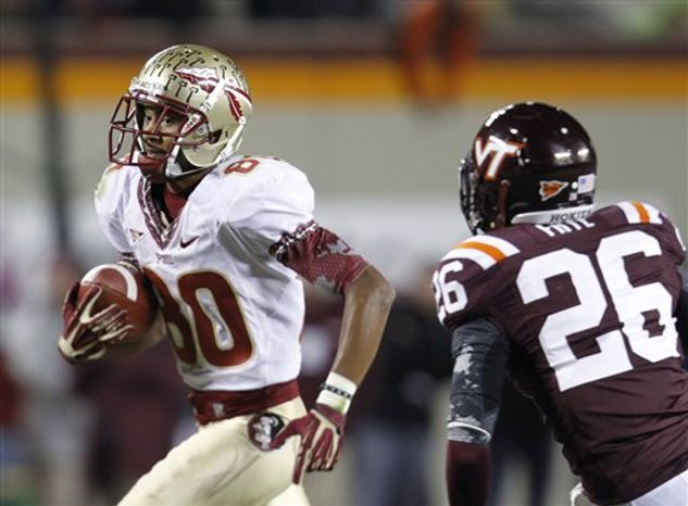 Florida State wide receiver Rashad Greene (80) heads to the end zone in front of Virginia Tech safety Desmond Frye (26) for the go-ahead touchdown during the second half of an NCAA football game in Blacksburg, Va., Thursday, Nov. 8, 2012. Florida State won the game 28-22. (AP Photo/Steve Helber)