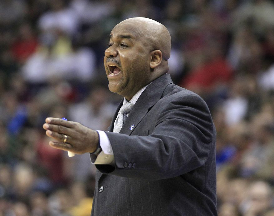 FILE - In this March 18, 2012 file photo, Georgetown University head basketball coach John Thompson III reacts during  a basketball game in Columbus, Ohio. There is not a single senior on coach Thompson's roster. And only two juniors are expected to see significant minutes. their best player is Otto Porter, a sophomore. Two other members of the starting lineup also could be guys who were freshmen a year ago, Greg Whittington and Mikael Hopkins.  (AP Photo/Tony Dejak, File)