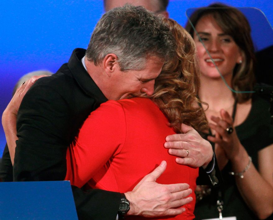 Former U.S. Sen. Scott Brown (left), Massachusetts Republican, hugs his wife, Gail Huff, at the conclusion of his concession speech Nov. 6, 2012, at an Election Night watch party in a hotel in Boston. Brown lost to Democratic challenger Elizabeth Warren in his bid for re-election. (Associated Press)