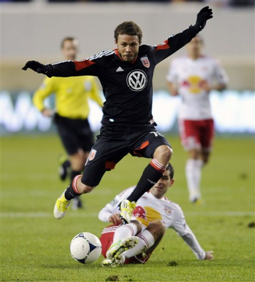 D.C. United midfielder Nick DeLeon, top, leaps over New York Red Bulls defender Rafa Marquez, bottom, during the first half of an MLS Eastern Conference semifinal playoff game on Thursday, Nov. 8, 2012, in Harrison, N.J. (AP Photo/Bill Kostroun)