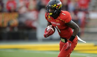 Maryland wide receiver Stefon Diggs (1) carries the ball against North Carolina State during the first half of an NCAA college football game, Saturday, Oct. 20, 2012, in College Park, Md. (AP Photo/Nick Wass)