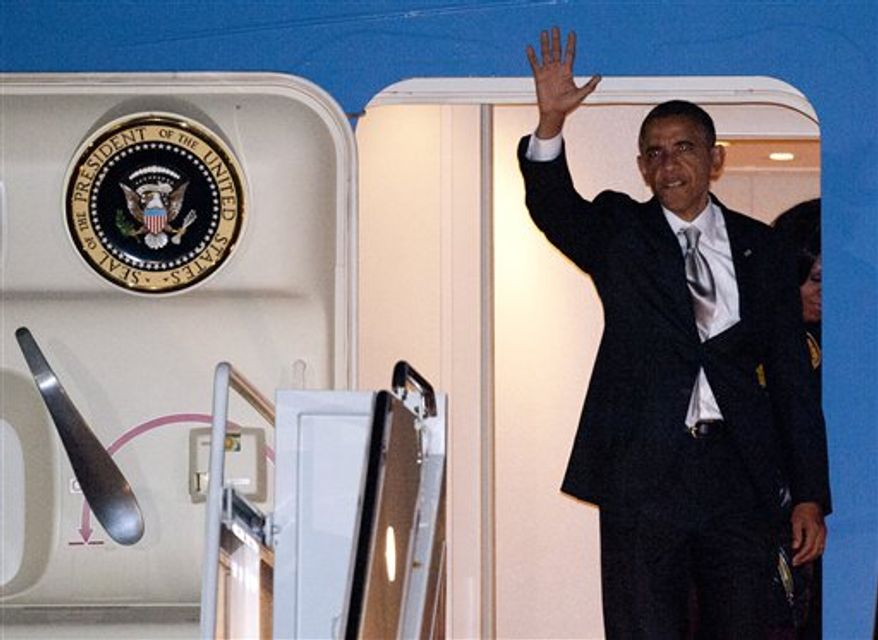 President Obama exits Air Force One at Andrews Air Force Base, Md., the day after he was re-elected President, Wednesday, Nov. 7, 2012. (AP Photo/Cliff Owen)