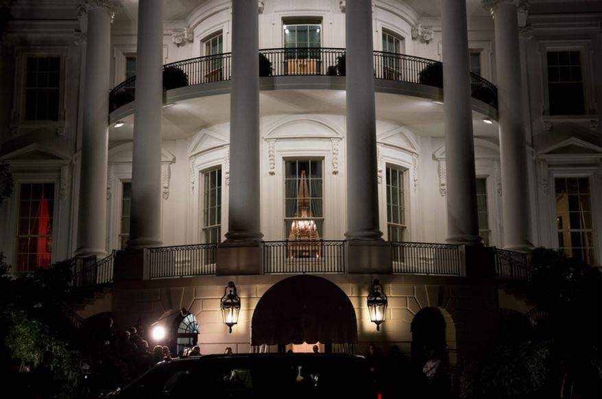 ** FILE ** President Obama and his family arrive Nov. 7, 2012, in their vehicle to the North Portico of the White House in Washington for the first time after his re-election. (Associated Press/The New York Times)