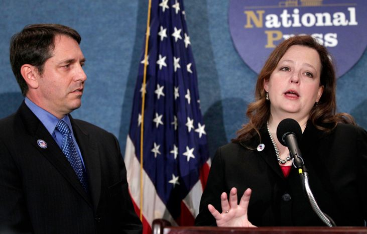 **FILE** Tea Party Patriots National founders and coordinators Mark Meckler (left) and Jenny Beth Martin take part in a news conference Sept. 21, 2010, at the National Press Club in Washington to announce that the organization received a major donation. (Associated Press)