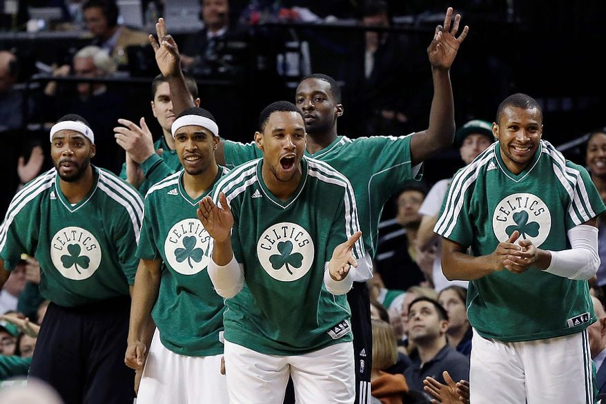 Boston Celtics players, from left, Chris Wilcox, Courtney Lee, Jared Sullinger, Jeff Green and Leandro Barbosa cheer from the bench late in an NBA basketball game against the Washington Wizards in Boston, Wednesday, Nov. 7, 2012. The Celtics won 100-94 in overtime. (AP Photo/Elise Amendola)