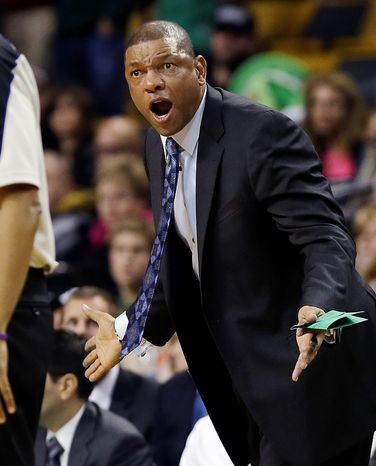 Boston Celtics coach Doc Rivers yells to an official during the second half of an NBA basketball game against the Washington Wizards in Boston, Wednesday, Nov. 7, 2012. The Celtics won 100-94 in overtime. (AP Photo/Elise Amendola)
