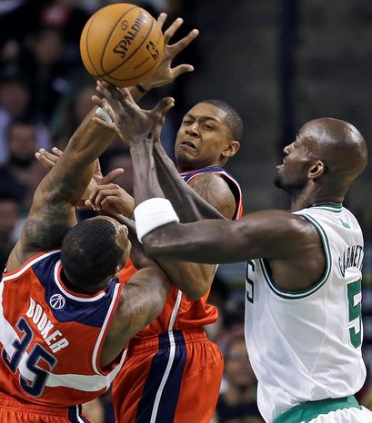 Washington Wizards forward Trevor Booker (35) and guard Bradley Beal, middle, vie for a loose ball with Boston Celtics forward Kevin Garnett (5) during the first half of an NBA basketball game in Boston on Wednesday, Nov. 7, 2012. (AP Photo/Elise Amendola)