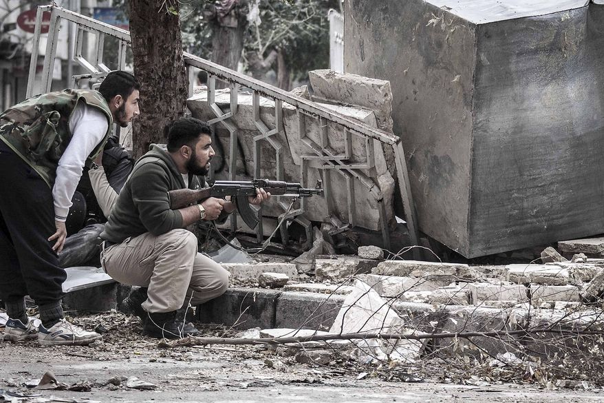 Syrian rebel fighters take cover Oct. 26, 2012, as a Syrian army sniper aims over a destroyed mosque in Tarik Al-Bab, southeast of Aleppo, Syria. (Associated Press) ** FILE **