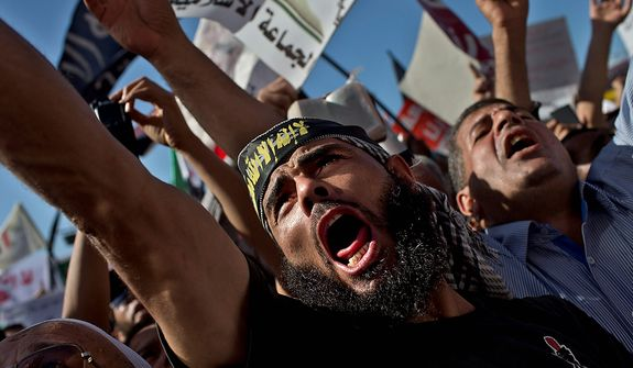 Egyptian Muslims shout Islamic slogans during a Nov. 9, 2012, rally in Tahrir Square in Cairo. Thousands of ultraconservative Muslims rallied in the Egyptian capital, demanding the country's new constitution be based on the rulings of Islamic law, or Shariah. (Associated Press)