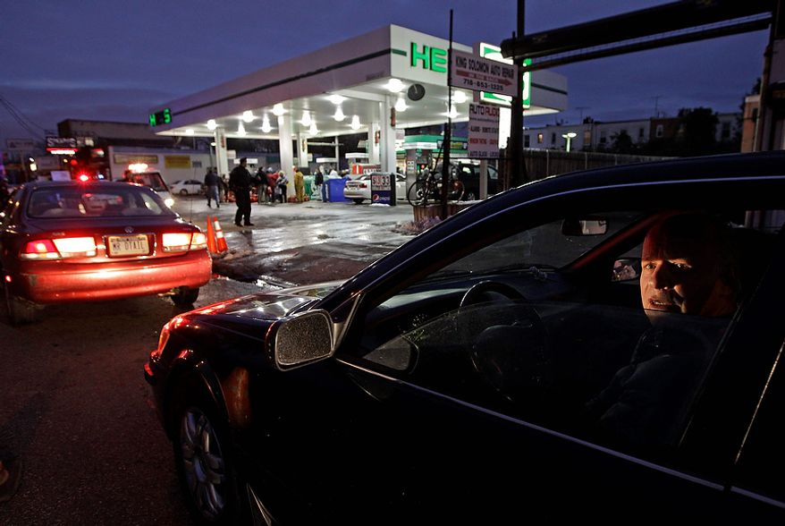 David Kahana, who said he had been sitting on line for one hour and 40 minutes, waits in line to purchase gasoline in the Brooklyn borough of New York on Nov. 8, 2012. Fuel shortages and distribution delays that occurred after Superstorm Sandy and a nor'easter hit the region led to gas hoarding, prompting New York City and Long Island to initiate an even-odd gas rationing plan. (Associated Press)