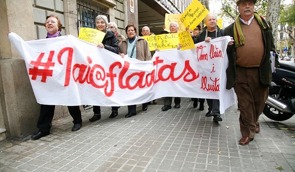**FILE** Yayoflautas occupy the Barcelona headquarters of the Catalan private healthcare provider's association on Dec. 22, 2011, in protest against cuts in health spending. (Oscar Martinez/Special to The Washington Times)