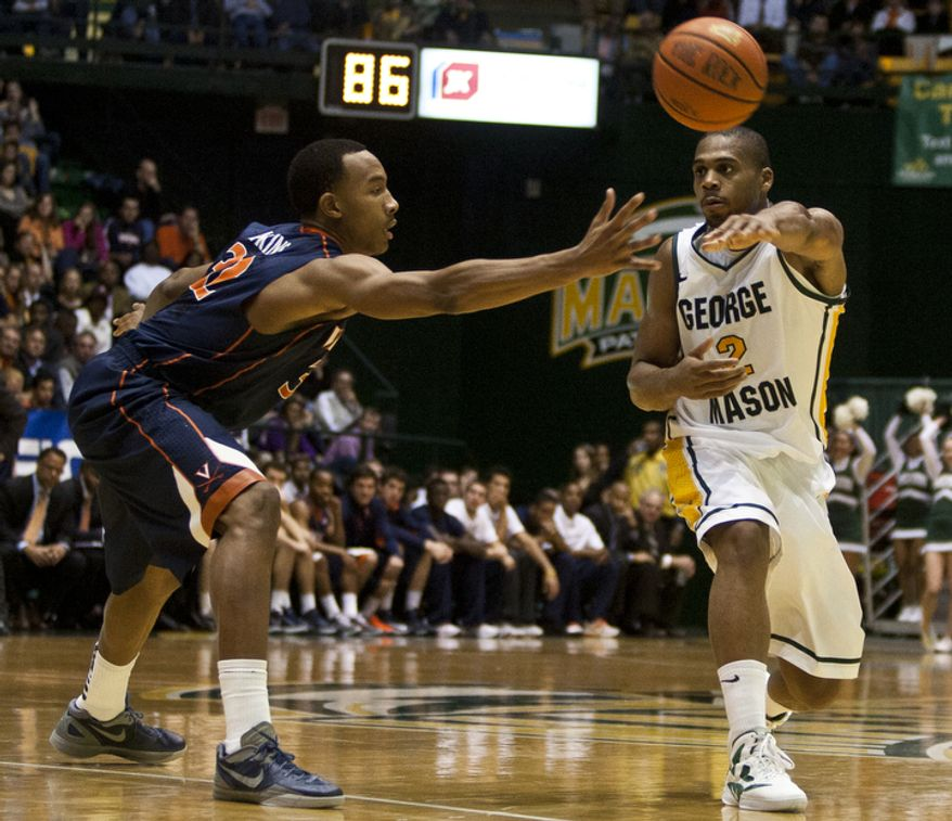 ** FILE ** George Mason Patriots forward Johnny Williams (2) passes the ball against the Virginia Cavaliers in the first half at the Patriot Center in Fairfax, Va., Wednesday, November 9, 2012. (Craig Bisacre/The Washington Times)