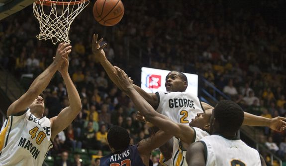 George Mason Patriots forward Johnny Williams (2) and forward Marko Gujanicic (40) attempt to rebound the ball over Virginia Cavaliers forward Darion Atkins (32) in the second half at the Patriot Center in Fairfax, Va., Wednesday, November 9, 2012. George Mason Patriots host the Virginia Cavaliers for the 2012-2013 men's college basketball season opener. (Craig Bisacre/The Washington Times)