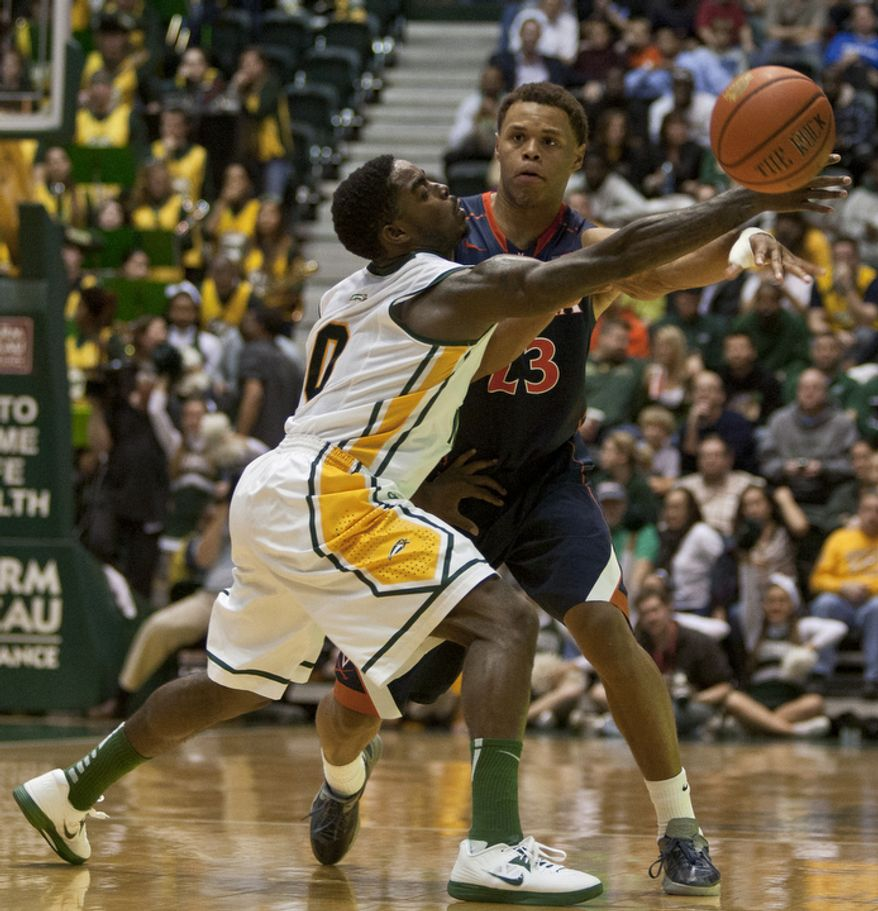 George Mason Patriots guard Bryon Allen (0) attempts to steal a pass by Virginia Cavaliers guard Justin Anderson (23) in the second half at the Patriot Center in Fairfax, Va., Wednesday, November 9, 2012. George Mason Patriots host the Virginia Cavaliers for the 2012-2013 men's college basketball season opener. (Craig Bisacre/The Washington Times)