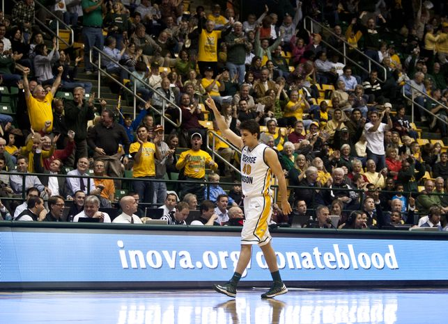 George Mason Patriots forward Marko Gujanicic (40) celebrates after hitting a three-point in the final second of the first half against the Virginia Cavaliers at the Patriot Center in Fairfax, Va., Wednesday, November 9, 2012. George Mason Patriots host the Virginia Cavaliers for the 2012-2013 men's college basketball season opener. (Craig Bisacre/The Washington Times)