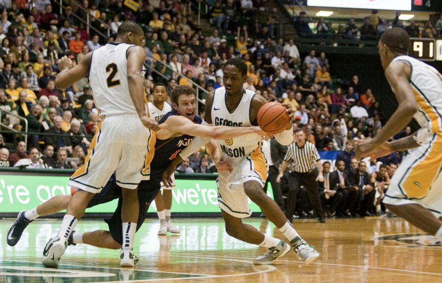 George Mason Patriots forward Jonathan Arledge (5) steals the ball from Virginia Cavaliers forward Evan Nolte (11) in the second half at the Patriot Center in Fairfax, Va., Wednesday, November 9, 2012. George Mason Patriots host the Virginia Cavaliers for the 2012-2013 men's college basketball season opener. (Craig Bisacre/The Washington Times)