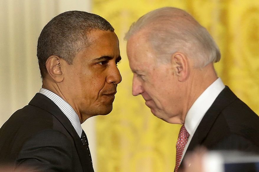 President Obama passes Vice President Joseph R. Biden after speaking on the economy and the deficit on Friday, Nov. 9, 2012, in the East Room of the White House in Washington. (Associated Press)