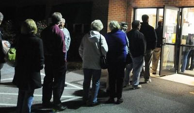 People line up Nov. 6, 2012, outside the Jackson Township Municipal Building in Lebanon, Pa., at about 6 p.m. to cast their vote in the 2012 election. (Associated Press/Lebanon Daily News, Jeremy Long)