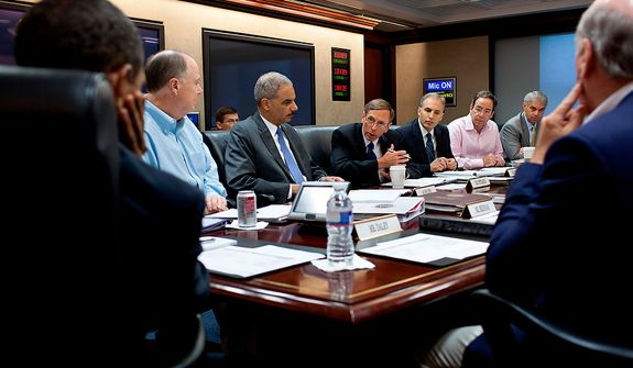 **FILE** President Obama listens as CIA Director David Petraeus makes a point during a national security meeting in the Situation Room of the White House. (Rex Features via Associated Press)