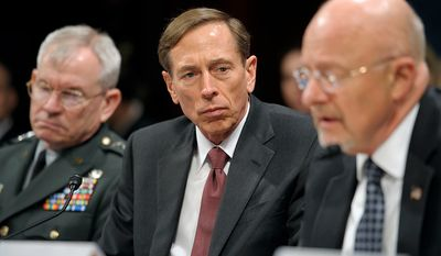 From left: Defense Intelligence Agency Director Army Lt. Gen. Ronald Burgess, CIA Director David Petraeus and Director of National Intelligence James Clapper testify on Capitol Hill in Washington on Feb. 2, 2012, before the House Intelligence Committee hearing on worldwide threats. (Associated Press)