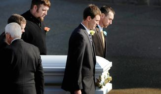 Pallbearers bring the casket of 2-year-old Maddox Derkosh into Saint Bernard Church in Mount Lebanon, Pa., for funeral services on Nov. 9, 2012. Derkosh was killed Nov. 4 after he fell from a wooden railing overlooking the painted dogs exhibit at the Pittsburgh Zoo and PPG Aquarium and bled to death after being mauled by the dogs.  (Associated Press/Pittsburgh Post-Gazette, Michael Henninger)