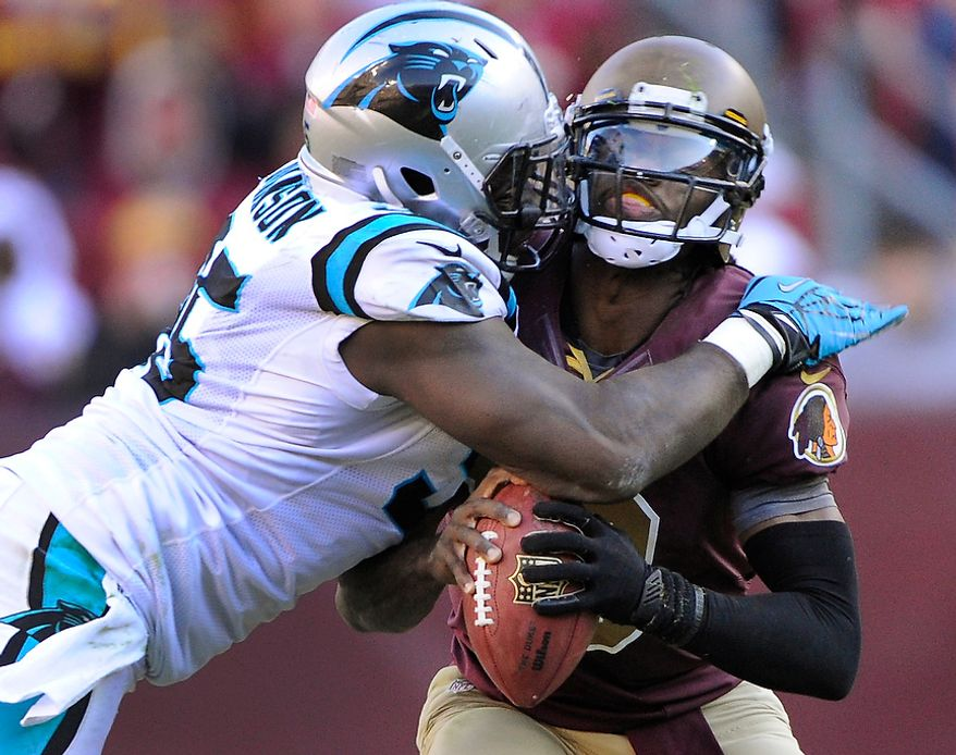 Washington Redskins quarterback Robert Griffin III (10) is sacked by Carolina Panthers defensive end Charles Johnson (95) in the fourth quarter at FedEx Field, Landover, Md., Nov. 4, 2012. (Preston Keres/Special to The Washington Times)at FedEx Field, Landover, Md., Nov. 4, 2012. (Preston Keres/Special to The Washington Times)