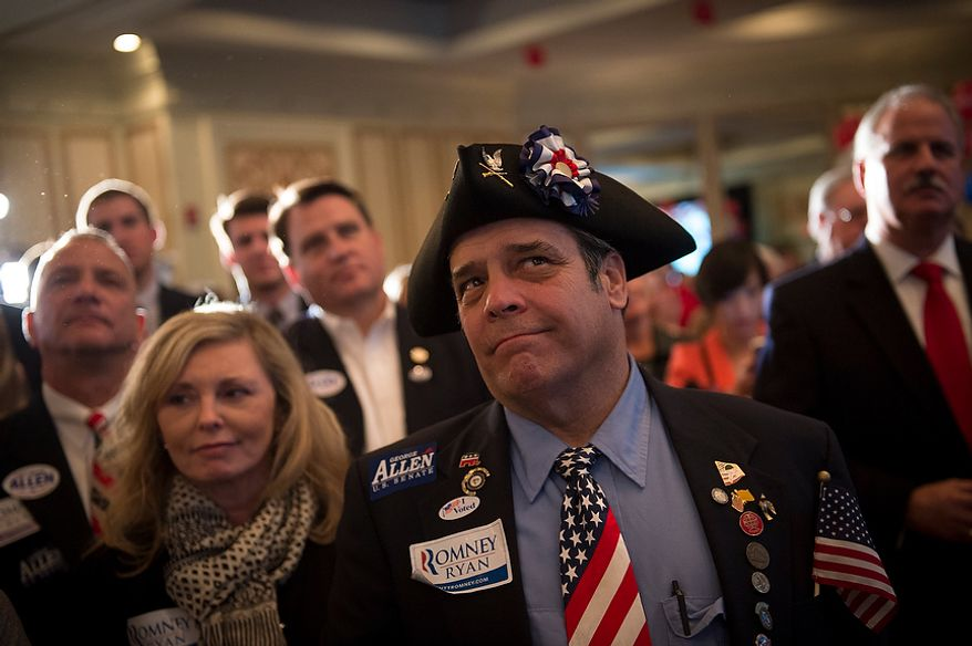 John Wallmeyer, of Ashland, Va., listens as Republican U.S. Senate candidate and former Virginia Governor George Allen concedes the senate race to former Virginia Governor Tim Kaine during his election night party event at the Omni Richmond Hotel in Richmond, Va., Tuesday, Nov. 6, 2012. (Rod Lamkey Jr./The Washington Times)