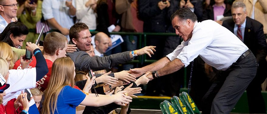 Republican presidential candidate, former Massachusetts Gov. Mitt Romney shakes hands during a campaign rally at The Patriot Center, George Mason University in Fairfax, Va. Monday, Nov. 5, 2012 (Craig Bisacre/The Washington Times)