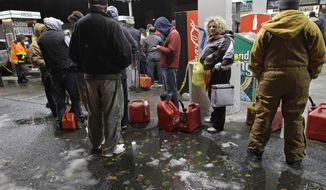 People wait in line Nov. 8, 2012, for gasoline at a Hess station in the Brooklyn borough of New York. Fuel shortages and distribution delays that occurred after Superstorm Sandy and a nor'easter hit the region led to gas hoarding, prompting New York City and Long Island to initiate an even-odd gas rationing plan. (Associated Press)