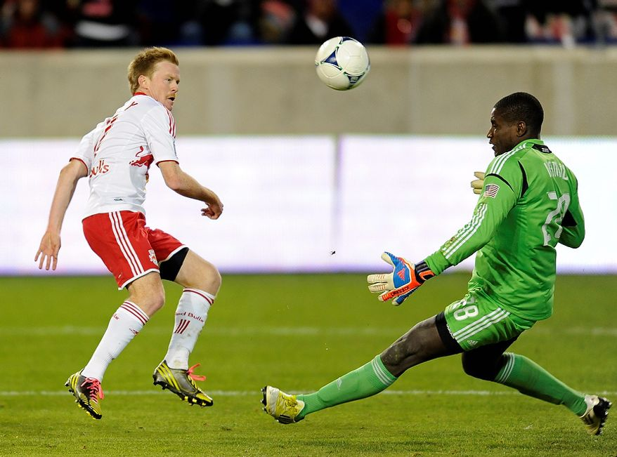 D.C. United goalkeeper Bill Hamid (right) makes a save on a shot by New York Red Bulls midfielder Dax McCarty during the second half of an MLS Eastern Conference semifinal playoff soccer game on Nov. 8, 2012, in Harrison, N.J. D.C. United defeated the Red Bulls, 1-0, to advance to the next round. (Associated Press)