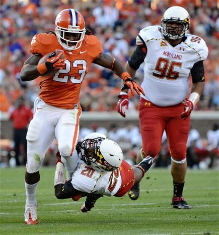 Clemson running back Andre Ellington shakes the tackle of Maryland's Anthony Nixon while A.J. Francis (96) pursues during the first half of an NCAA college football game Saturday, Nov. 10, 2012, at Memorial Stadium in Clemson, S.C. (AP Photo/Richard Shiro)