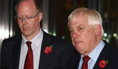 The BBC Director General, George Entwistle, left, stands with the Chairman of the BBC Trust, Lord Chris Patten, as he announces his resignation as Director General outside New Broadcasting House in central London, after recent news program problems, Saturday Nov. 10, 2012. (AP Photo/ Max Nash)