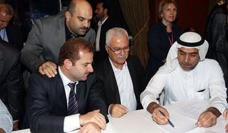 Syrian regime opponent George Sabra , center, during the vote count of the election of the Executive Office of the Syrian National Council in Doha, Qatar, Friday, Nov. 9, 2012. (AP Photo/Osama Faisal)