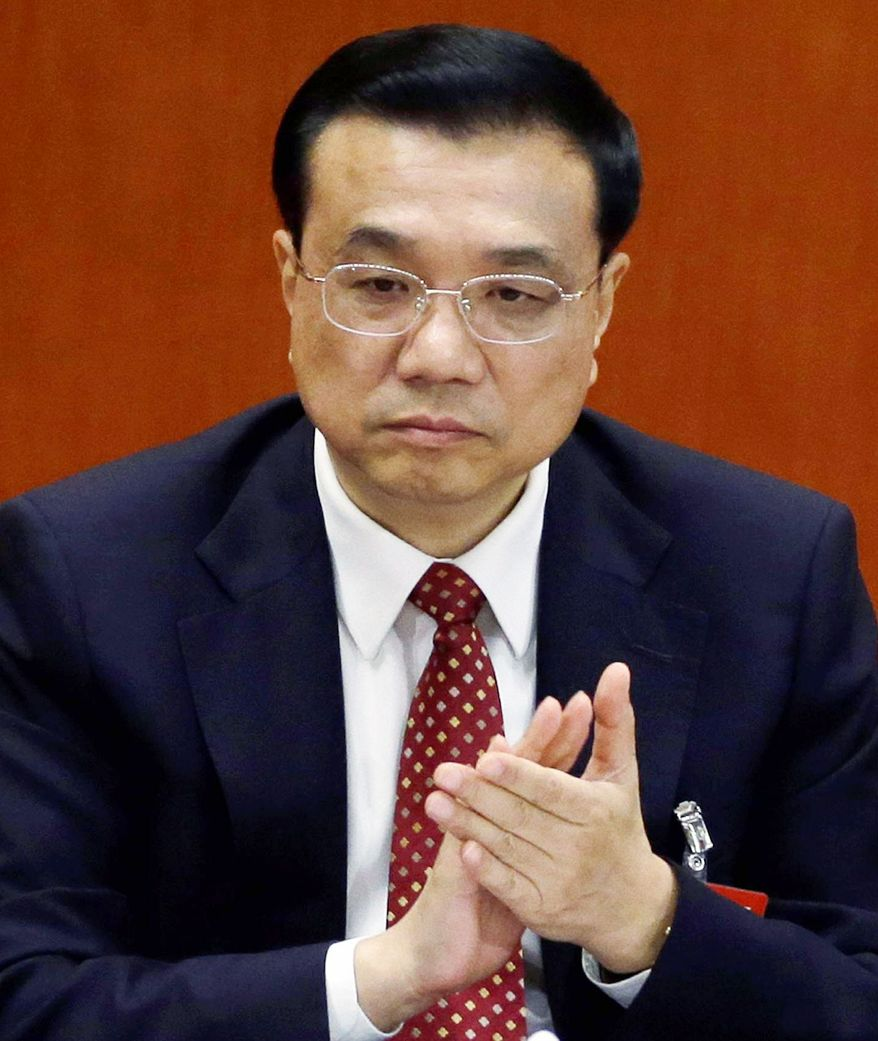 Chinese bureaucrat Li Keqiang is expected to take the economy-focused post of premier from outgoing politician Wen Jiabao. (Associated Press)