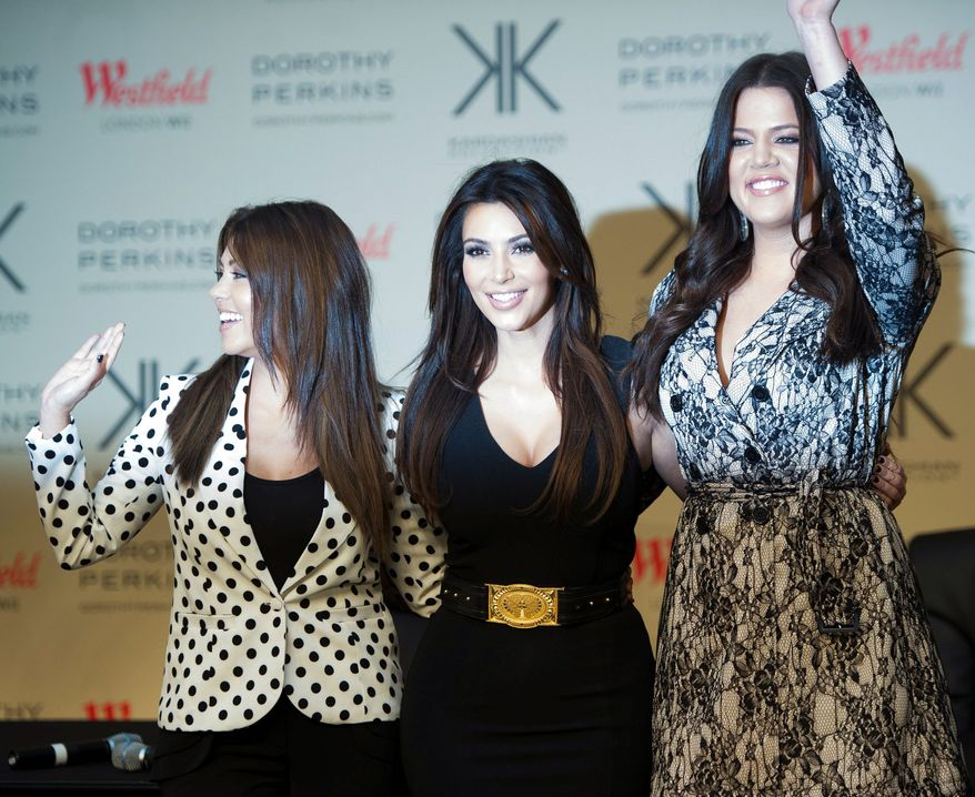 Kardashian sisters (from the left) Kourtney, Kim and Khloe are launching a Kardashian Kollection of clothes, to be sold at Dorothy Perkins stores in the U.K. (Associated Press)