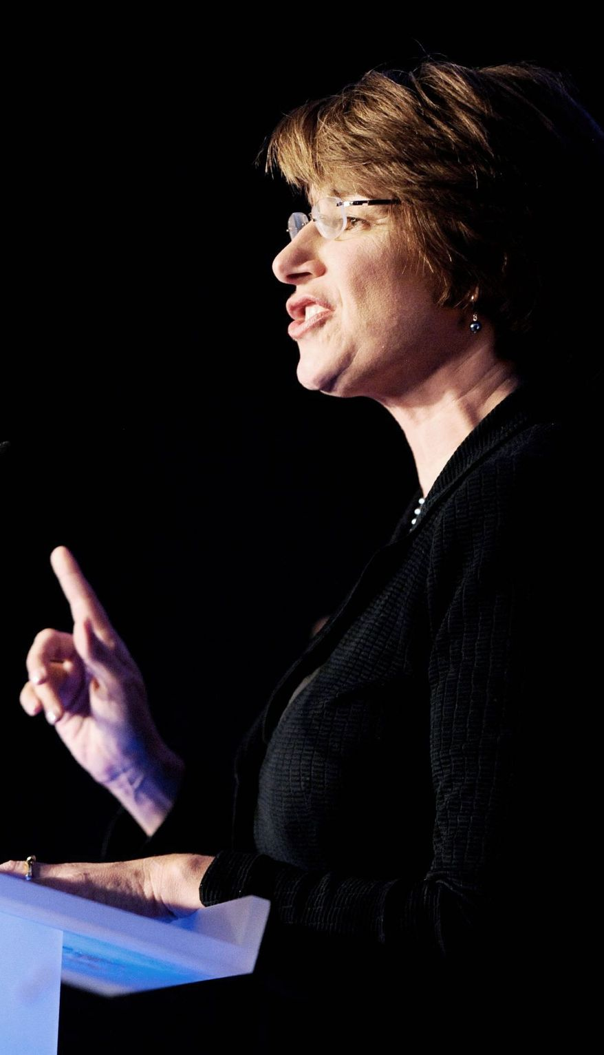 U.S. Sen. Amy Klobuchar, Minnesota Democrat, addresses supporters Tuesday night. With a Democratic governor and Democrats in control of the Legislature, Minnesota is heavily blue. (Associated Press)