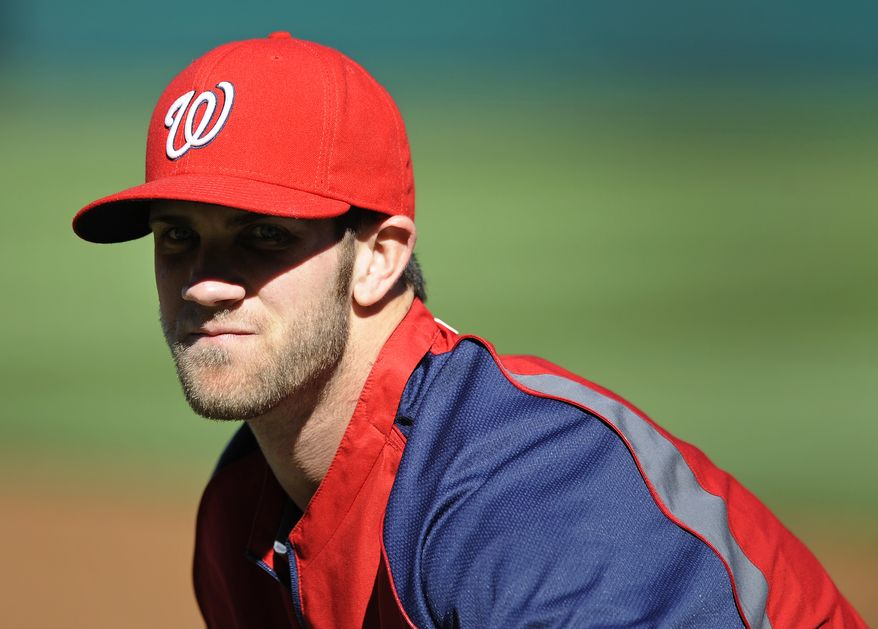 Nationals outfielder Bryce Harper is the favorite to win the Baseball Writers Association of America's Rookie of the Year award over Reds infielder Todd Frazier and Diamondbacks pitcher Wade Miley. (Associated Press)
