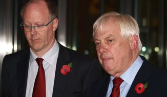 BBC Director General George Entwistle (left) stands with Lord Chris Patten, chairman of the BBC Trust, as he announces his resignation Nov. 10, 2012, outside New Broadcasting House in central London after recent news program problems. (Associated Press)