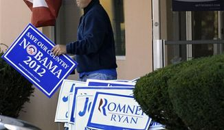 A man walks out of the Ohio headquarters of Mitt Romney campaign office carrying a Nobama 2012 sign, Wednesday, Nov. 7, 2012, in Columbus, Ohio. Romney conceded the presidential election shortly after midnight Wednesday. (AP Photo/Tony Dejak)